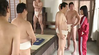 Japanese bitch in loincloth becomes cum dumpster for sumo wrestlers