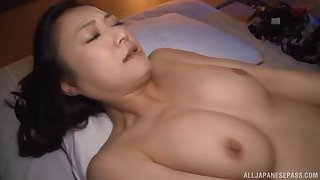 Passionate lovemaking atop the bed with gorgeous Japanese Nagasawa